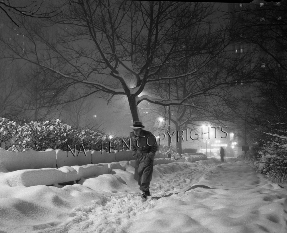 image 71 man walking in the snow by nat fein